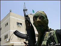 Hamas gunman outside the captured Preventative Security building