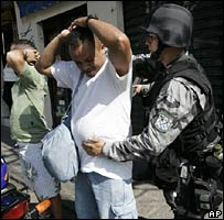 National Force officers conduct searches in a Rio shanty town