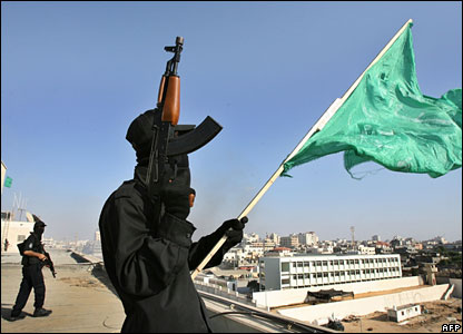 Hamas militant are seen on the rooftop of the Palestinian Intelligence Security compound in Gaza City