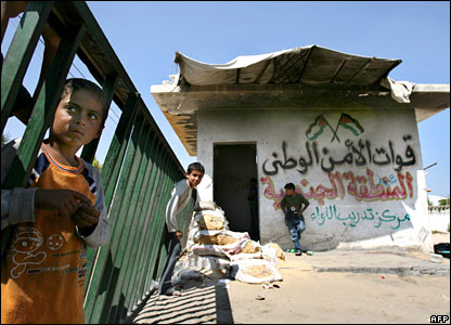 Palestinian children play in the abandoned guard house at the Palestinian security forces HQs seized by Hamas in the southern Gaza strip close to the town of Rafah