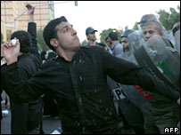 An Iranian throws an egg in the direction of the British embassy in Tehran