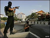 Masked Hamas militants outside the presidential compound in Gaza City (15 June)