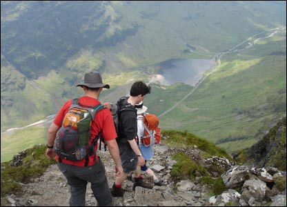 Walkers on  the Aonach Eagach ridge in Glencoe