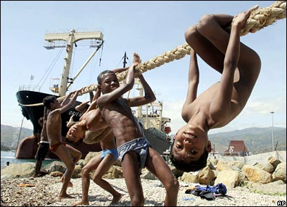 Children playing on mooring rope in East Timor