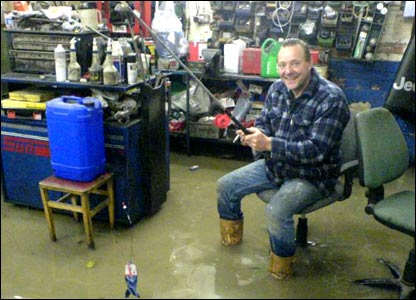 A man with a fishing rod in his garage [Pic: Nick Liggins]