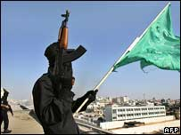 Hamas fighter on roof of Palestinian security compound
