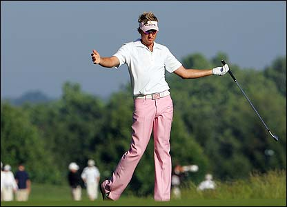 England's Ian Poulter reacts after missing a putt on the first