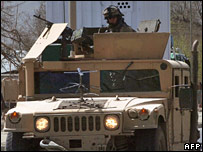 Soldiers patrolling the streets in an armoured car
