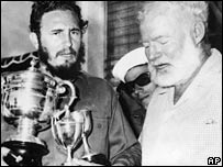American novelist Ernest Hemingway (R), stands next to Cuban Prime Minister Fidel Castro, who holds a trophy after winning the individual championship in the Hemingway Fishing Tournament in 1960
