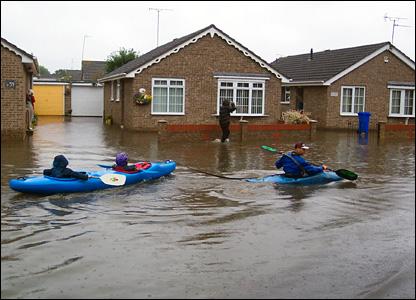 Canoes sailing down street (Pic: Jennifer Pugh)