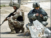An Iraqi and a US soldier patrol together in Baghdad