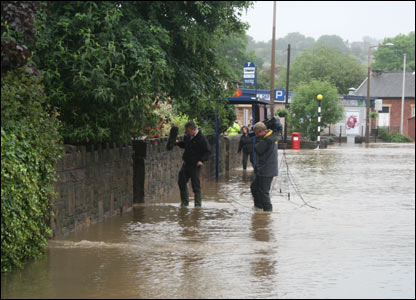 A film crew fall victim to floods [pic: Philip Cartwright]