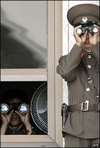 North Korean soldiers keep watch in the demilitarized zone bordering South Korea