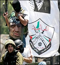 Fatah gunmen celebrate after taking over the parliament