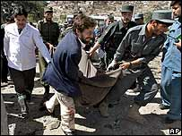 A bomb victim is carried away from the scene in Kabul