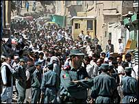 Police keep crowds away from the blast site