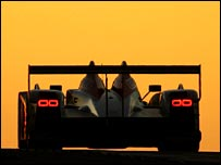 The Audi R10 driven by Frank Biela, Marco Werner and Emanuele Pirro at daybreak.