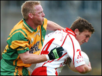 Dermot Carlin is tackled by Donegal's Brian Roper