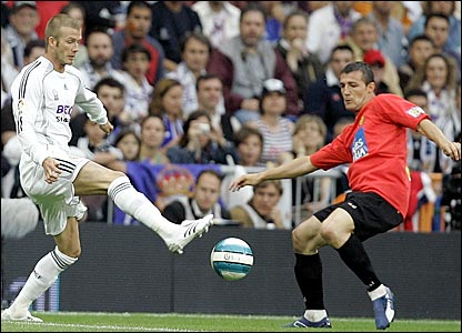 David Beckham (left) in action for Real Madrid against Mallorca