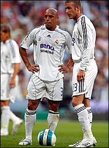 Roberto Carlos (left) and David Beckham in action for Real Madrid against Mallorca