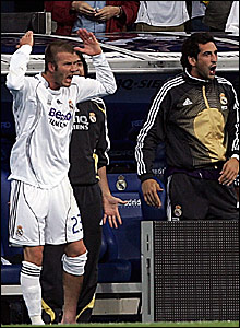 David Beckham shouts encouragement to his team-mates from the sidelines