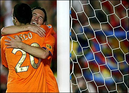 Lionel Messi is congratulated by team-mate Deco after scoring Barcelona's fourth goal