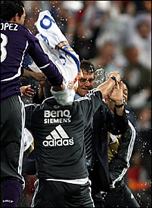 Real Madrid boss Fabio Capello (right) is drenched as celebrations start early