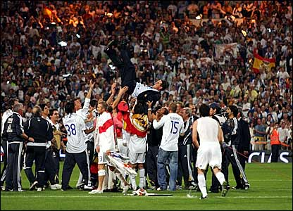 Real Madrid coach Fabio Capello is thrown into the air by his playersg