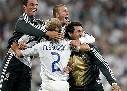 David Beckham (centre) celebrates winning La Liga with his Real Madrid team-mates