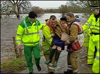 Pensioner being rescued from flood