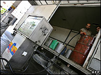 Gazans fill barrels with petrol