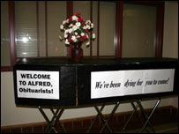 Coffin welcoming the obituarists to Alfred, NY