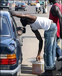 Fuel vendors try to sell fuel to a motorist on Lagos-Ikorodu highway, Nigeria
