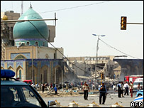 Rescuers inspect the damaged al-Khilani mosque in Baghdad