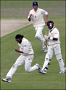 Monty Panesar (left) celebrates as Dwayne Bravo (right) departs for 43