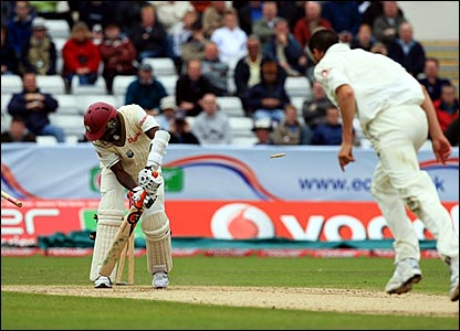 Fidel Edwards (left) is bowled by Steve Harmison