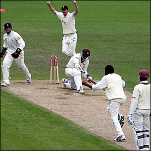 Shivnarine Chanderpaul (centre) is bowled