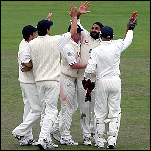 Monty Panesar (centre) is congratulated after finishing with 5-46