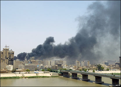 Smoke billows over Baghdad