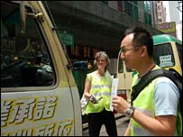 Annelise Connell and Phil Hueng confronting drivers with idling engines