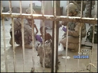 US troops look after the orphans (Image: CBS News)