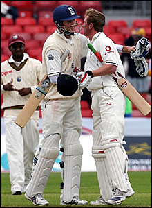 England captain Michael Vaughan (left) and Paul Collingwood embrace after defeating the West Indies