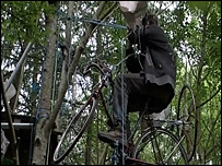 Protestor on a bike in the trees
