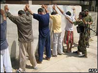 Iraqi soldiers search suspects in Baquba. Photo: 19 June 2007