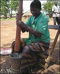 Leorina Lakot pounding maize