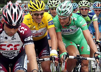 Switzerland's Fabian Cancellara in the yellow jersey and Tom Boonen in the green
