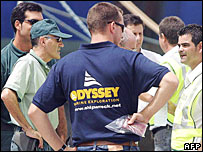 Spanish civil guard officers talk to Odyssey official
