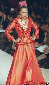 Model wearing long YSL red dress
