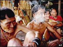 Members of the Penan sitting in a hut