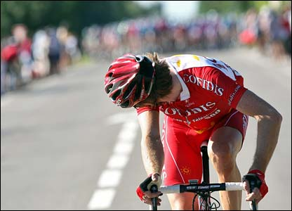 Bradley Wiggins looks behind at the peloton